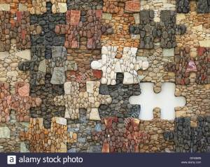 a-jigsaw-puzzle-with-missing-piece-mosaic-made-of-materials-like-stones-DFH9MN